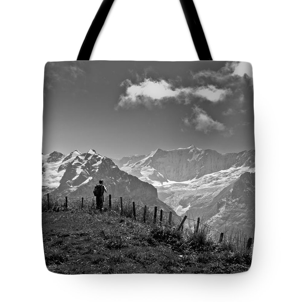 Alps Tote Bag featuring the photograph Hiker In The Alps by Aquadro Photography