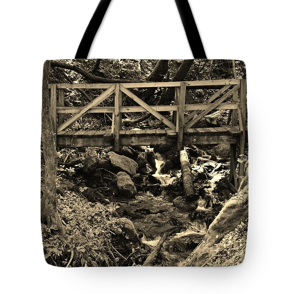 Footbridge Tote Bag featuring the photograph hikers Bridge over the Creek by Stacie Siemsen