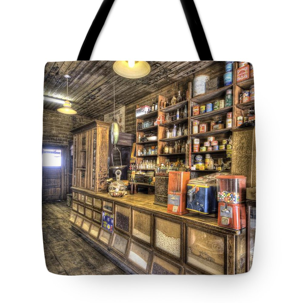 General Store Wood Stove Supplies Storage Historic Northern Arizona Country Livin Tote Bag featuring the photograph Historic General Store by Thomas Todd