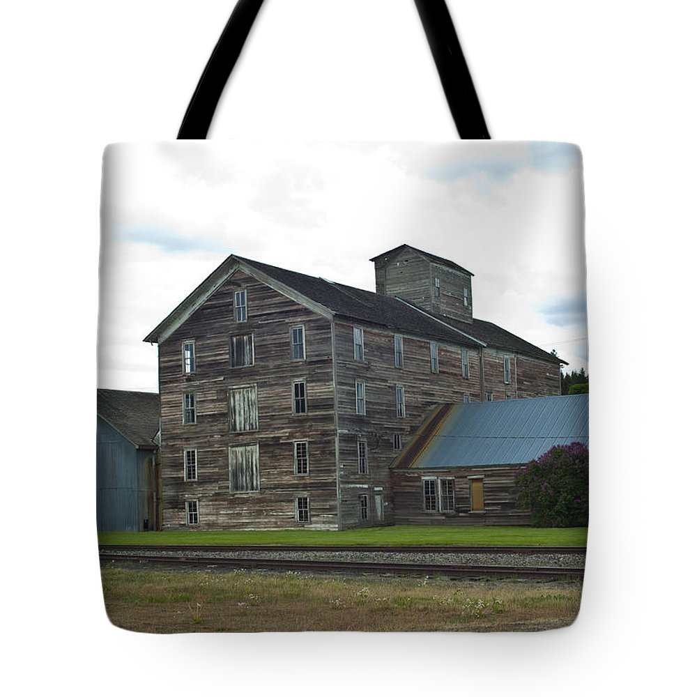 Historical Tote Bag featuring the photograph Historical Barron Wheat Flour Mill In Oakesdale Wa by Louise Magno