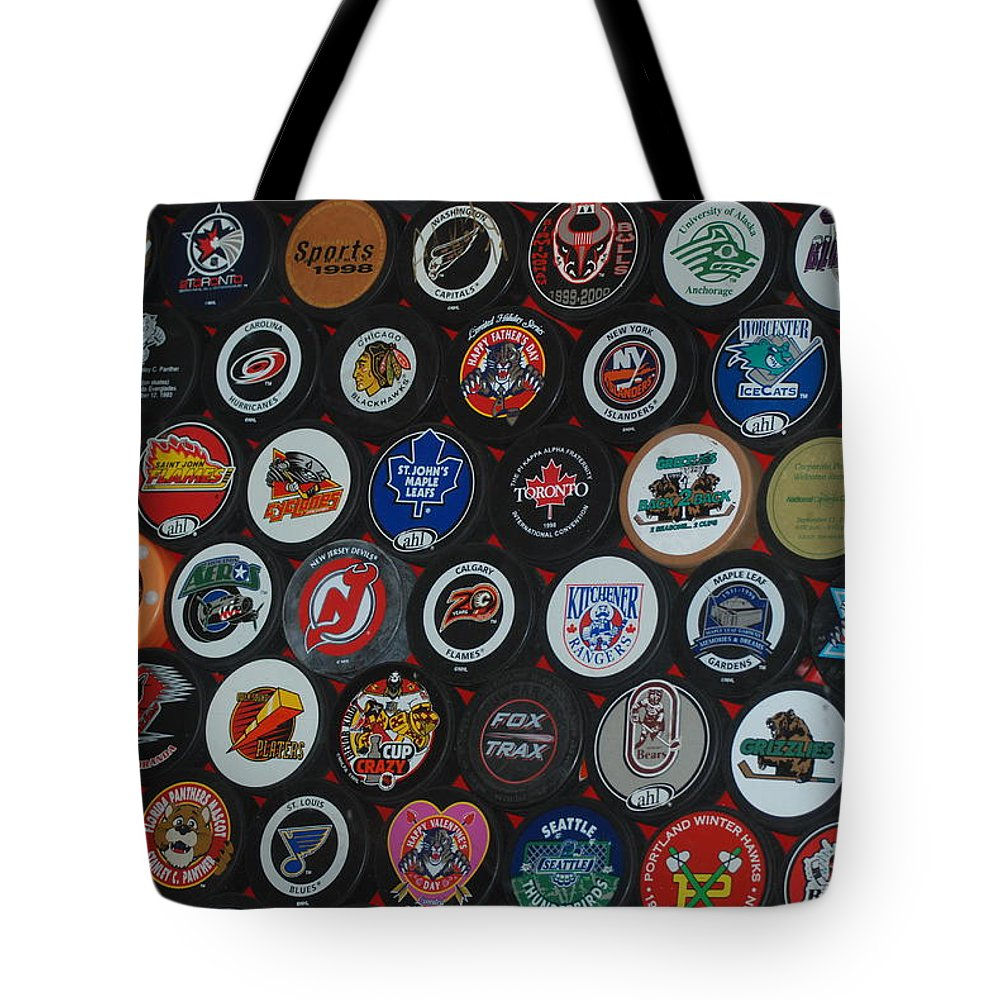 Pop Art Tote Bag featuring the photograph Hockey Pucks by Rob Hans