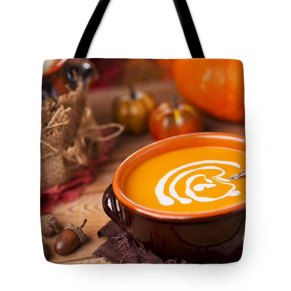 Pumpkin Soup Tote Bag featuring the photograph Homemade Pumpkin Soup On A Rustic Table With Autumn Decorations by Sara Winter