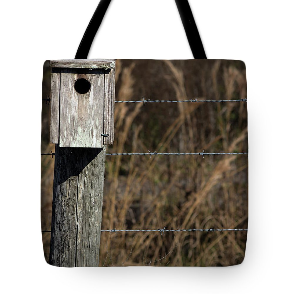 Birdhouse Tote Bag featuring the photograph House On A Crooked Fence Post by By Way of Karma