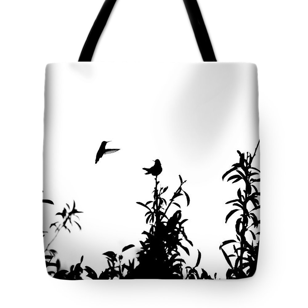 Bird Tote Bag featuring the photograph Hummingbird Silhouettes #1 by Eric Strickland