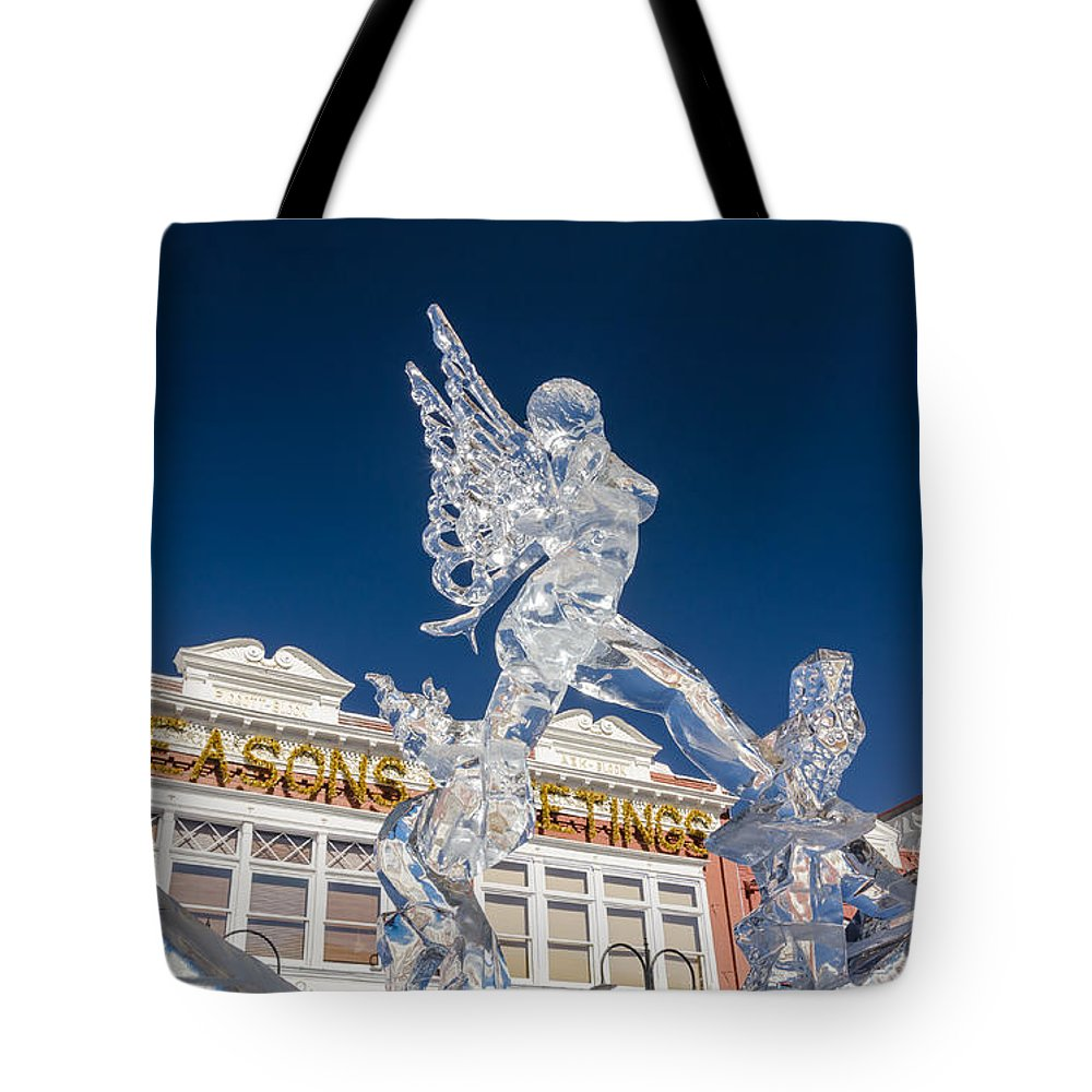 Ice Formations Tote Bag featuring the photograph The Annual Ice Sculpting Festival In The Colorado Rockies, The Allure Of A Siren by Bijan Pirnia