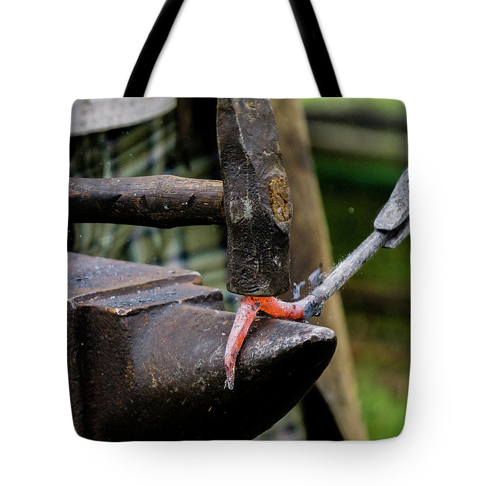 Blacksmith Tote Bag featuring the photograph Impact by John Gagnon