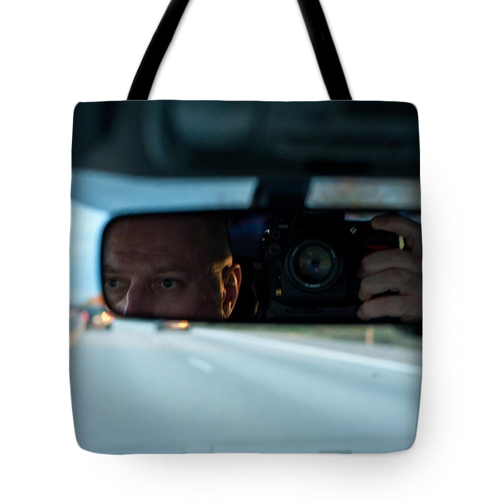 Driving Tote Bag featuring the photograph In The Road by Steven Dunn