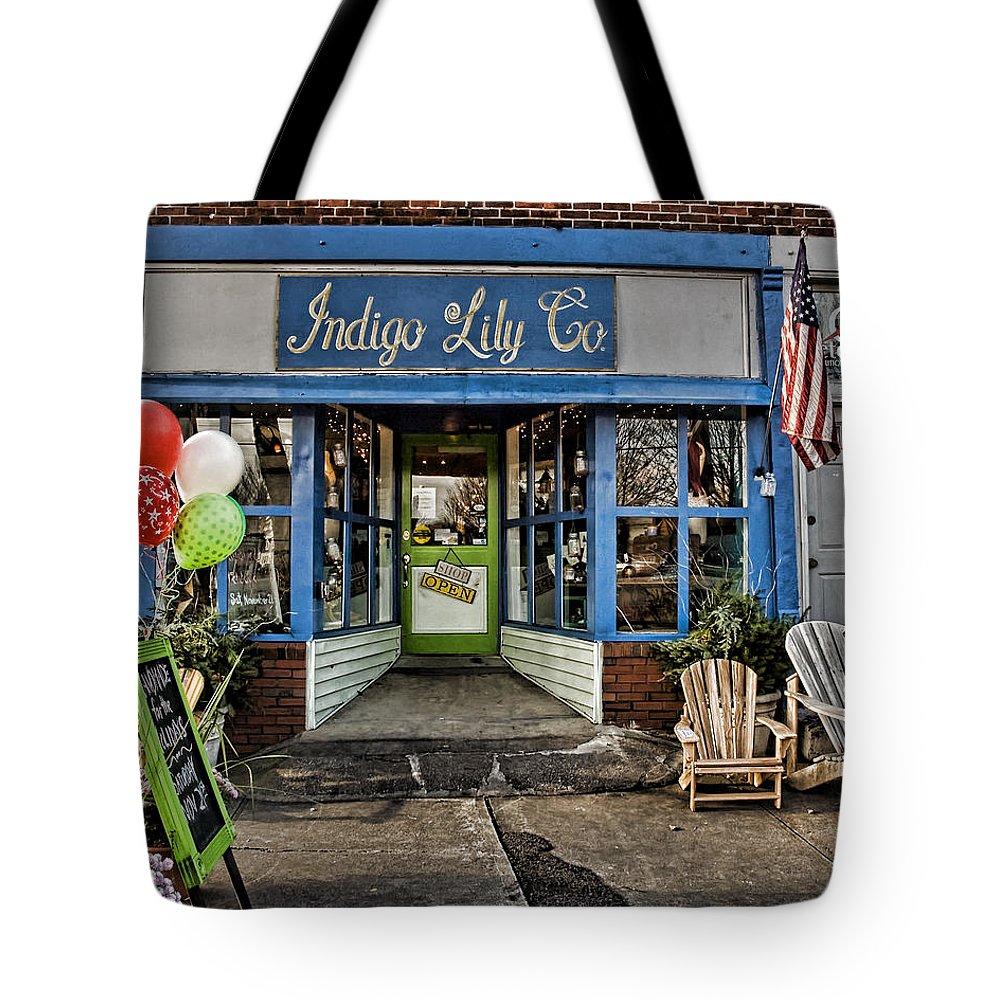 Shop Tote Bag featuring the photograph Indigo Lily by Edward Sobuta