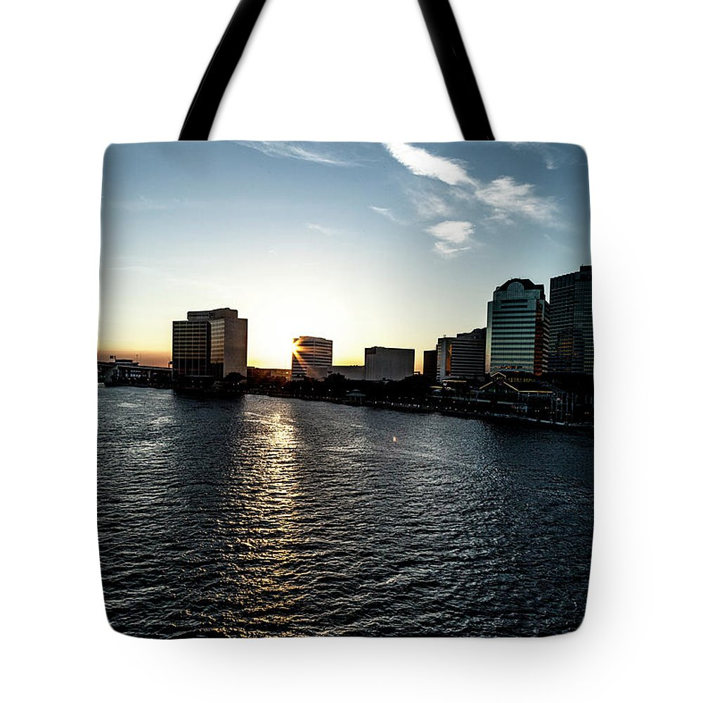 Cityscape Tote Bag featuring the photograph Influential Light by Eric Christopher Jackson