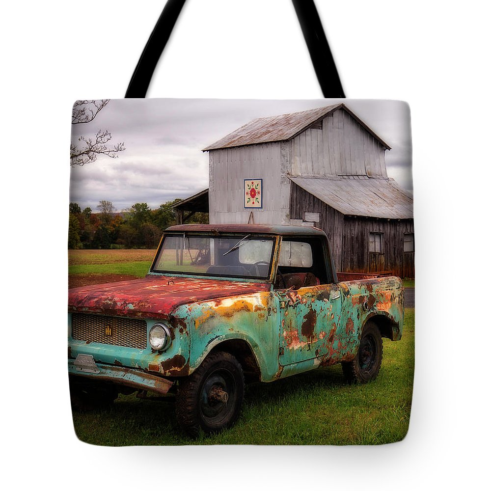 International Tote Bag featuring the photograph International Scout by Alan Raasch