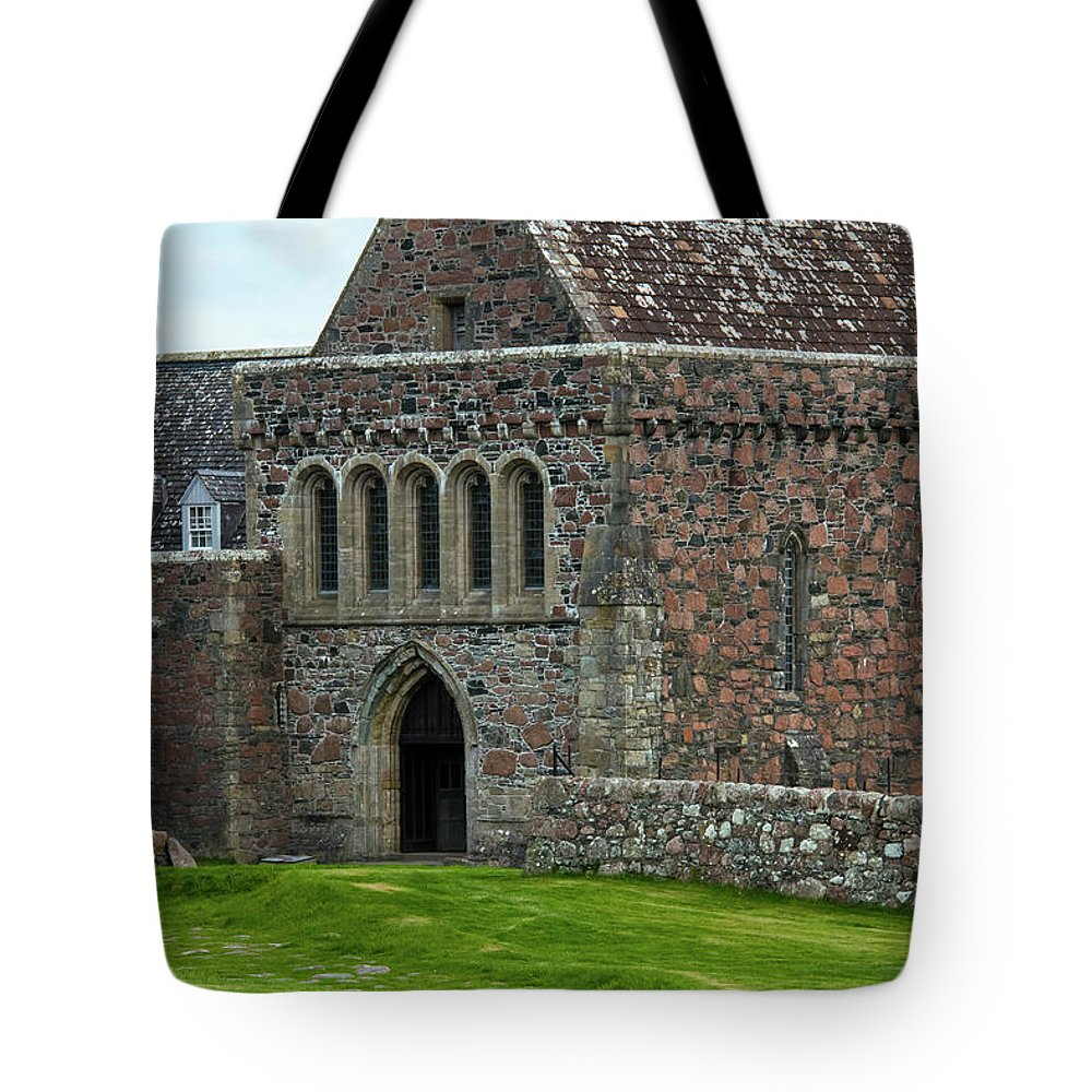 Isle Of Iona Tote Bag featuring the photograph Iona Abbey by Bob Phillips