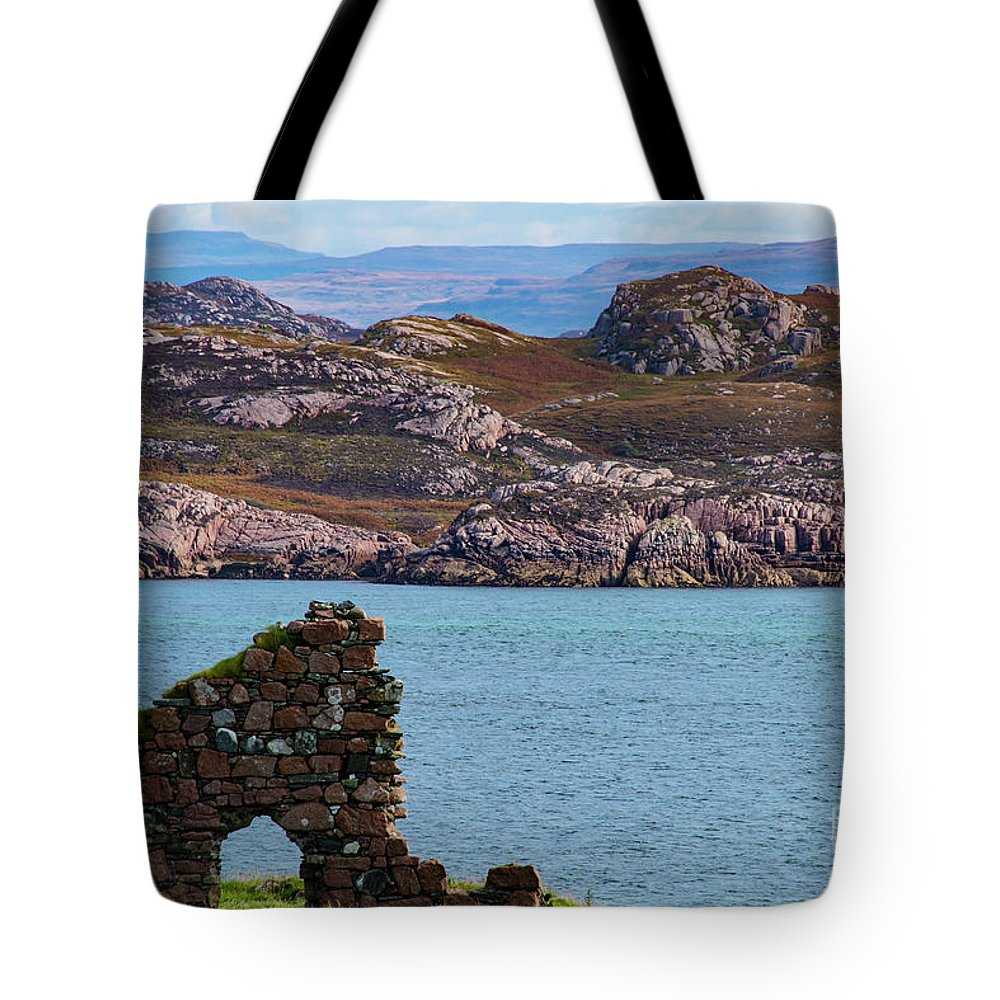 Isle Of Iona Ruins Tote Bag featuring the photograph Iona Ruins And Mull Hills by Bob Phillips