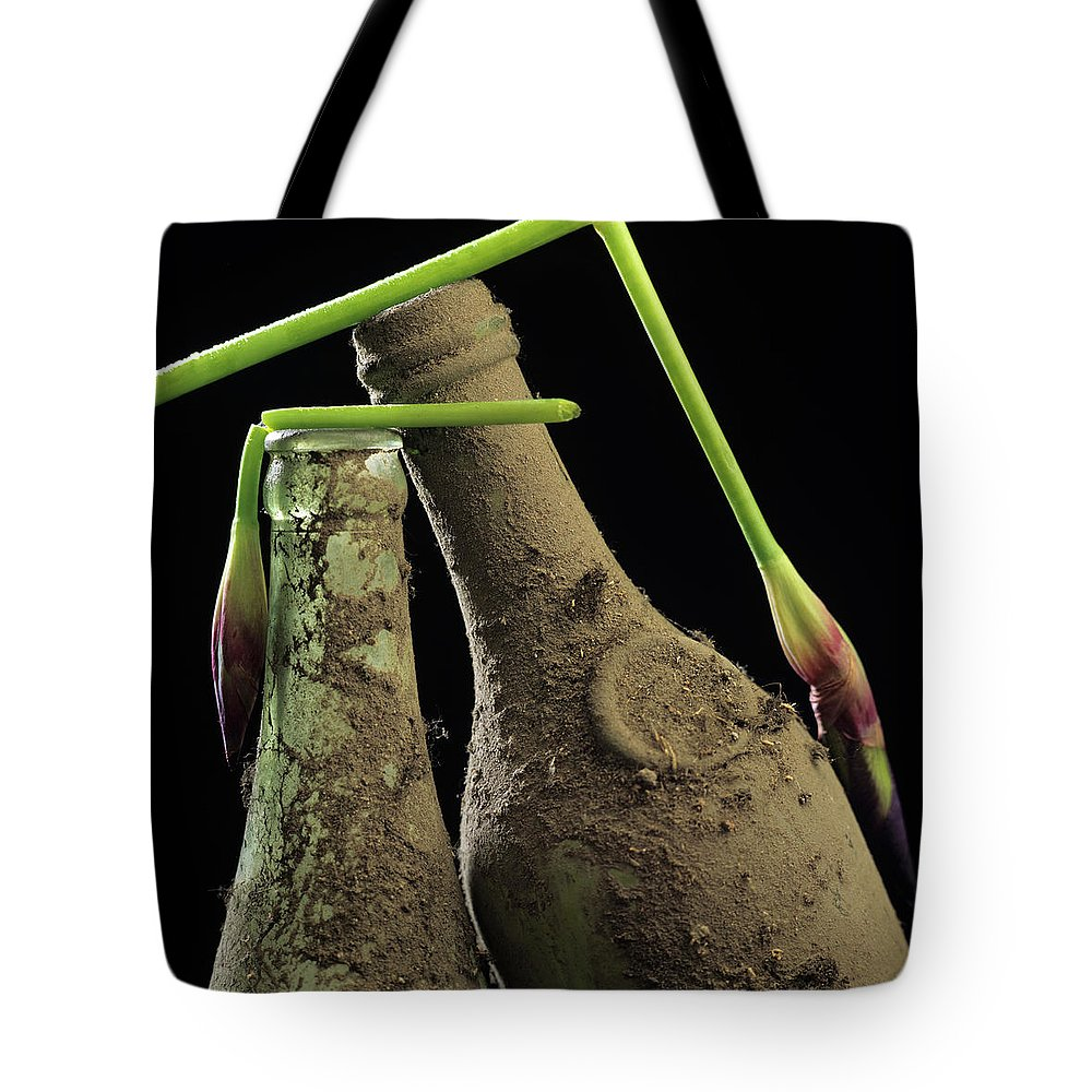 Aged Tote Bag featuring the photograph Iris And Old Bottles by Bernard Jaubert