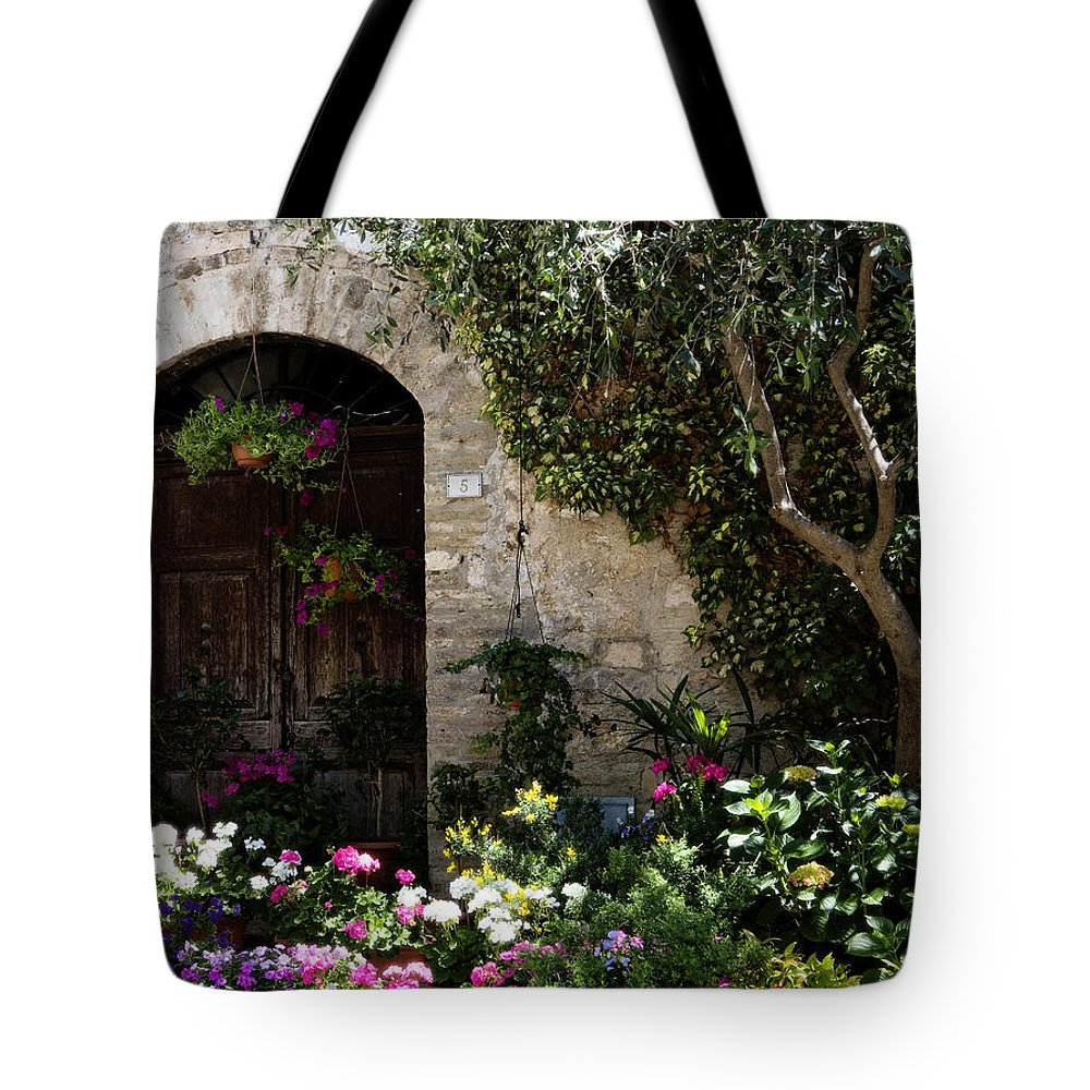 Flower Tote Bag featuring the photograph Italian Front Door Adorned With Flowers by Marilyn Hunt