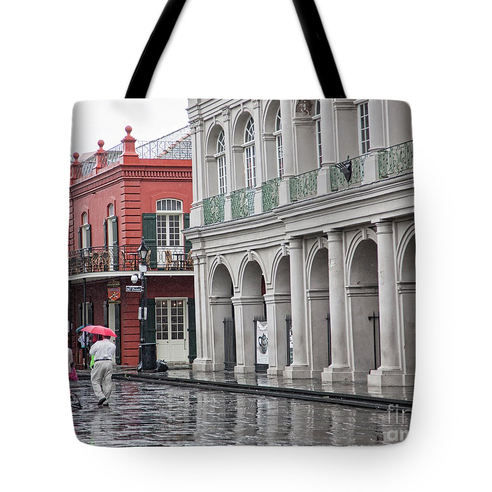 Jackson Square Tote Bag featuring the photograph Jackson Square Rainy Day by Chuck Kuhn