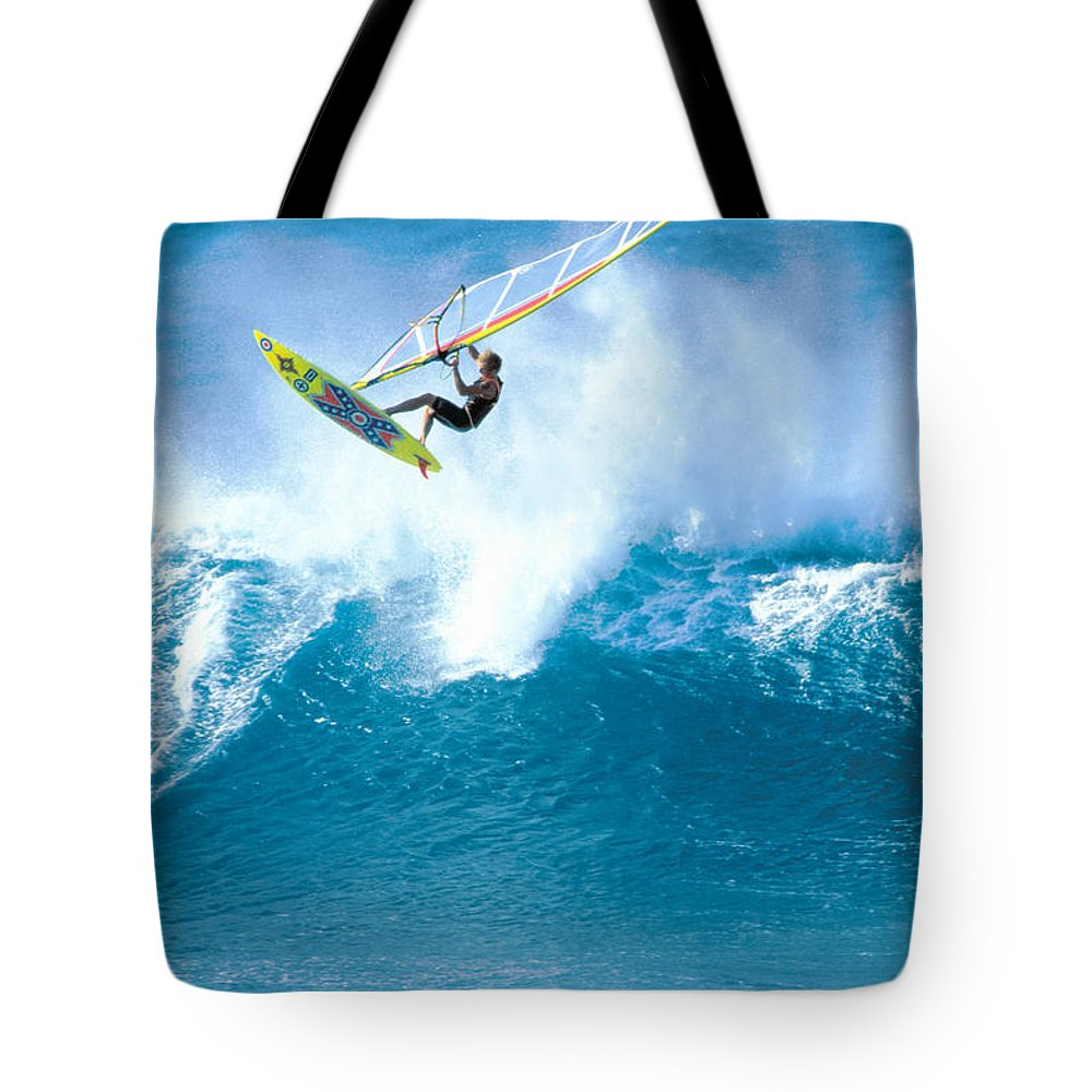 Adrenaline Tote Bag featuring the photograph Jason Flies Over A Wave by Erik Aeder - Printscapes