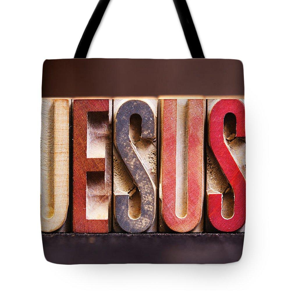 Jesus Tote Bag featuring the photograph Jesus - Antique Letterpress Letters by Donald Erickson