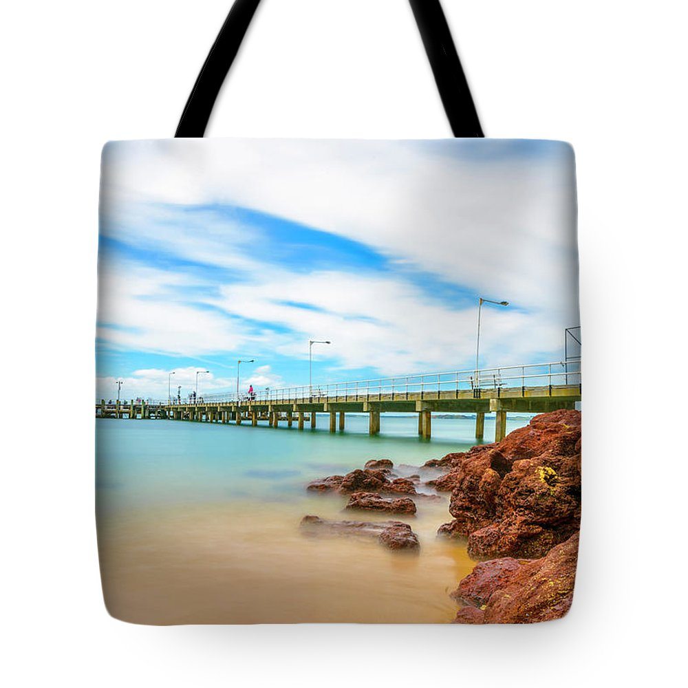 Landscapes Tote Bag featuring the photograph Jetty By The Sea by DesignBoard Photography