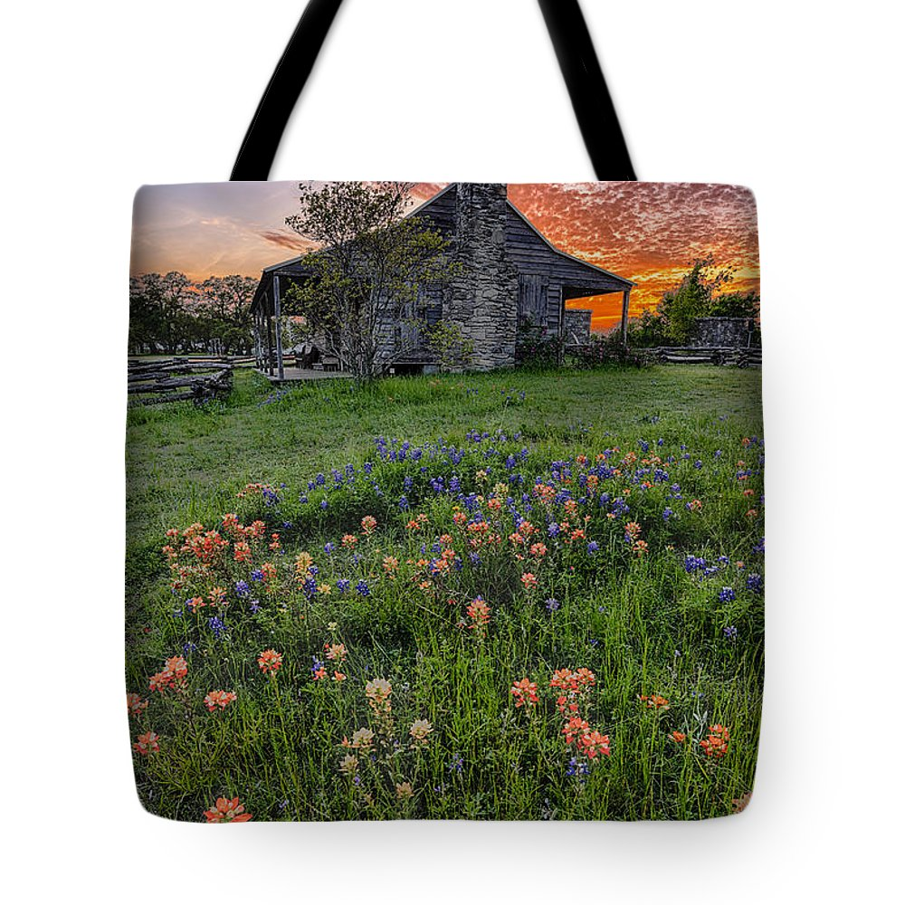 Independence Tote Bag featuring the photograph John P Coles Cabin And Spring Wildflowers At Independence - Old Baylor Park Brenham Texas by Silvio Ligutti