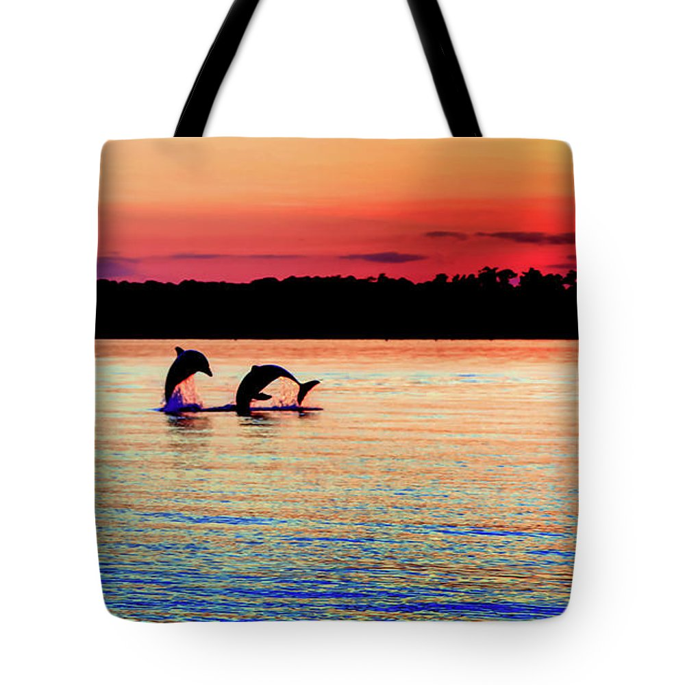 Dolphins Tote Bag featuring the photograph Joy Of The Dance by Karen Wiles
