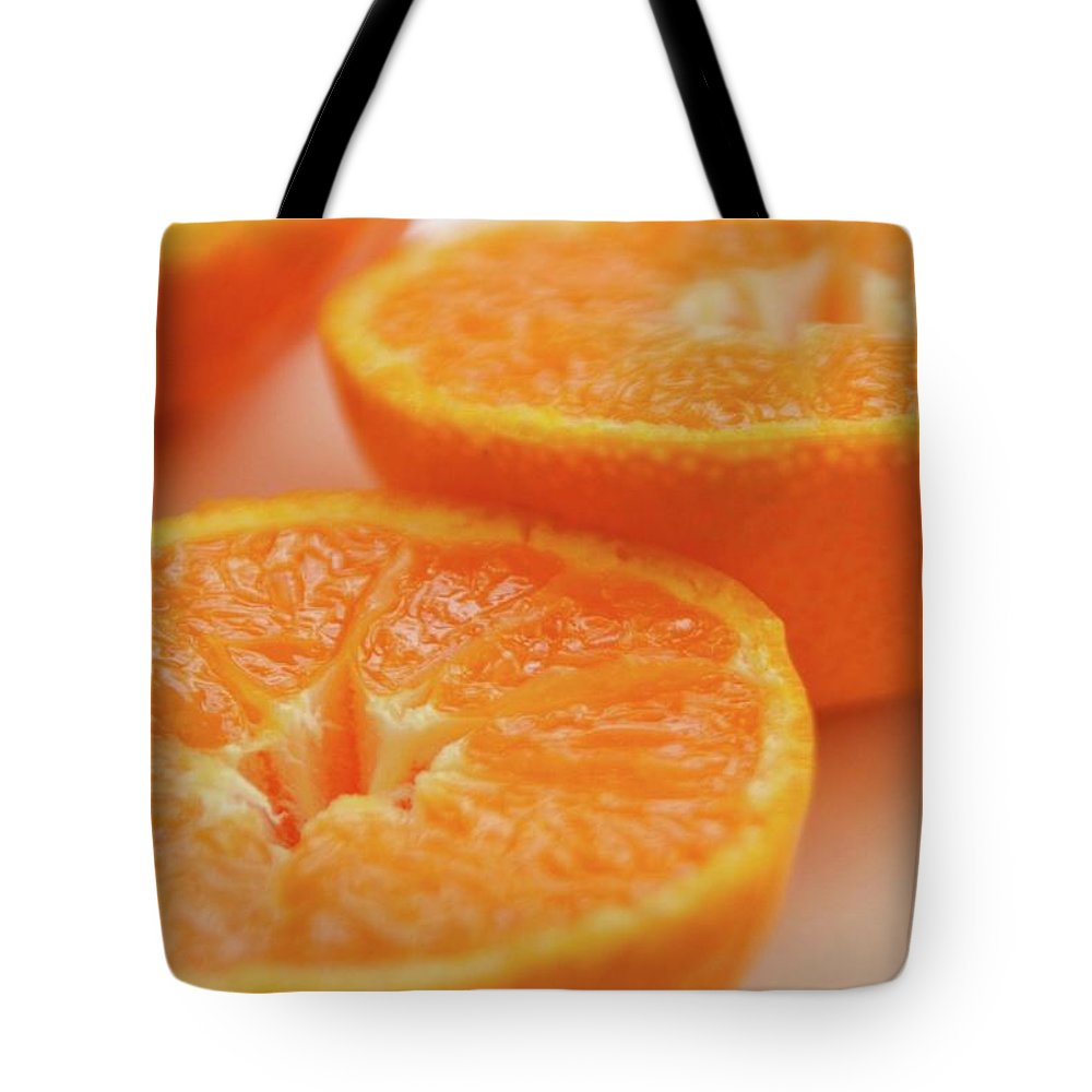 Orange Tote Bag featuring the photograph Juicy by Michael Mathis