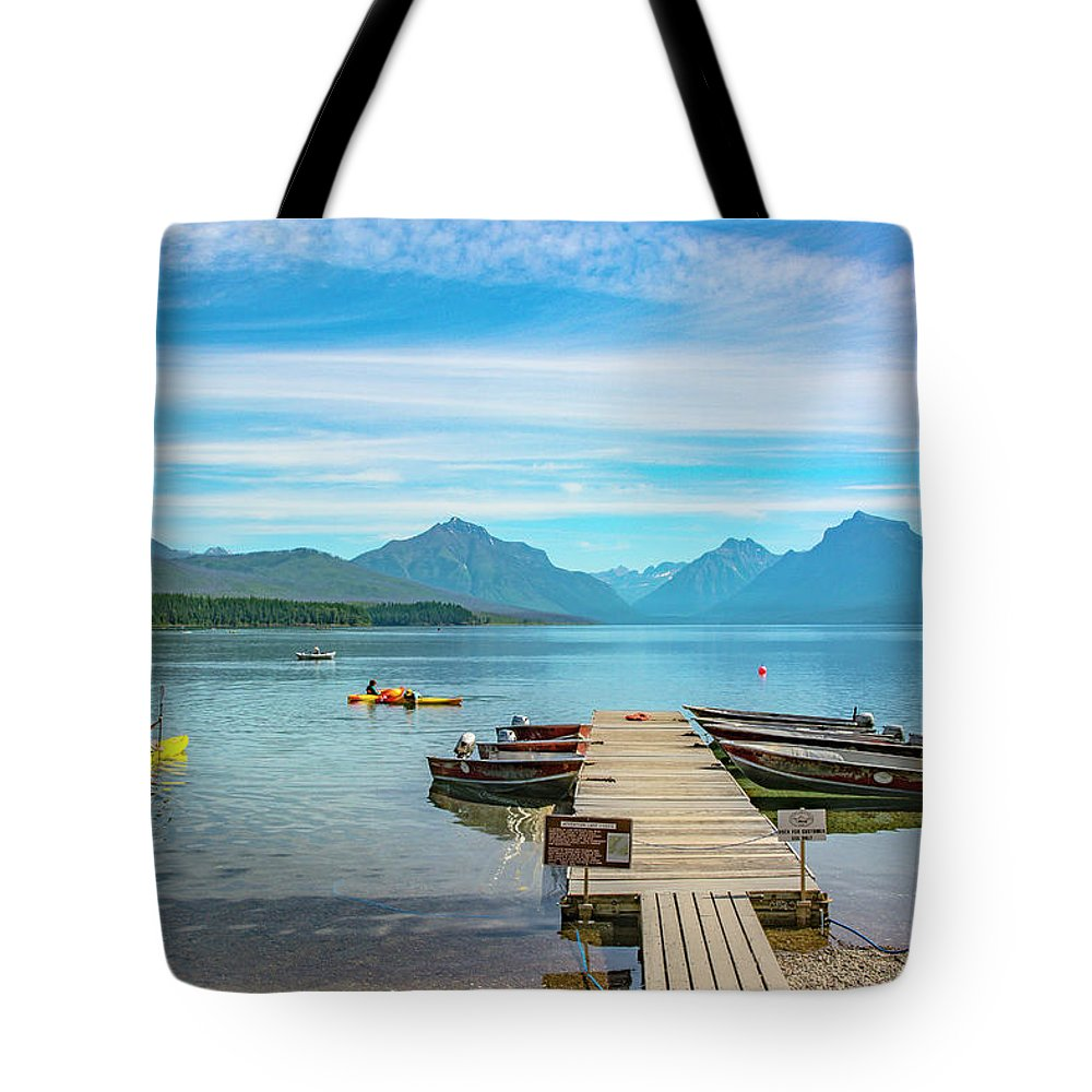 Montana Tote Bag featuring the photograph July 4th on Lake McDonald by Bryan Spellman
