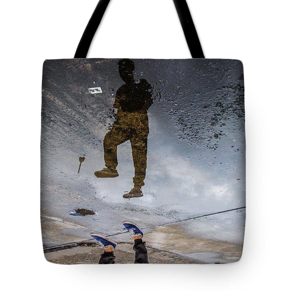 Jump Tote Bag featuring the photograph Jump Rotate by Jordan Pigi