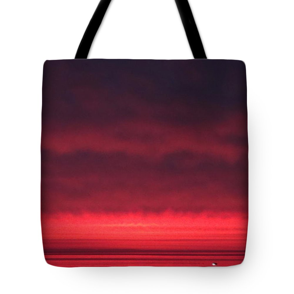 June's Pink Sunrise Tote Bag featuring the photograph June's Pink Sunrise 2017 by Nicola Graham