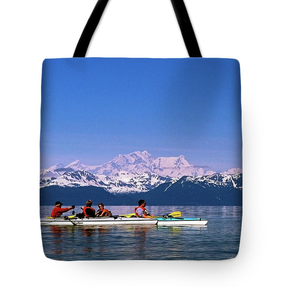 Kayaks Tote Bag featuring the photograph Kayakers In Alaska by Sally Weigand
