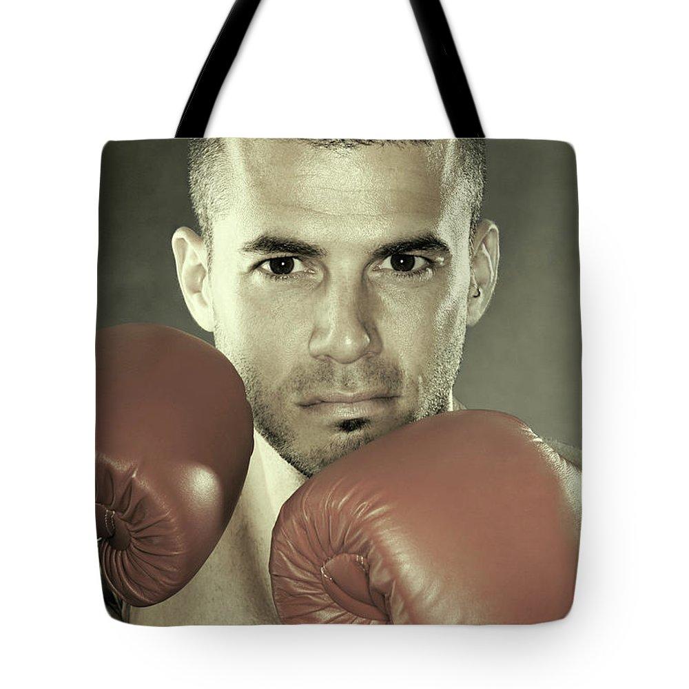 Kickboxer Tote Bag featuring the photograph Kickboxer by Oleksiy Maksymenko