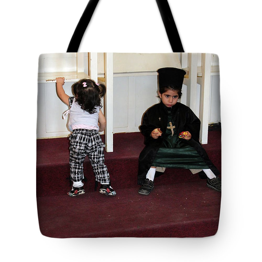Kid Tote Bag featuring the photograph Kids And Religion by Munir Alawi