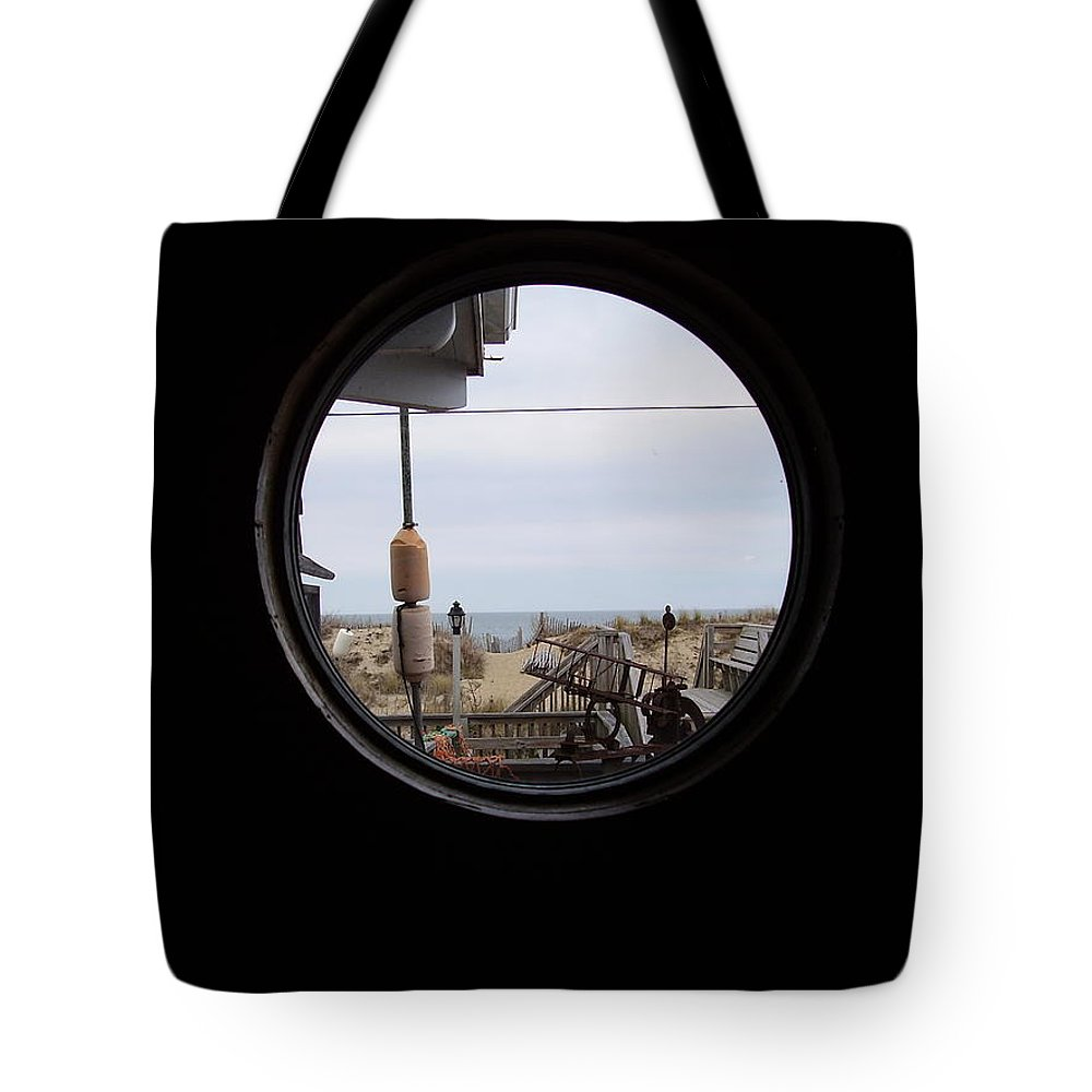 Kitty Hawk Tote Bag featuring the photograph Kitty Hawk by Flavia Westerwelle