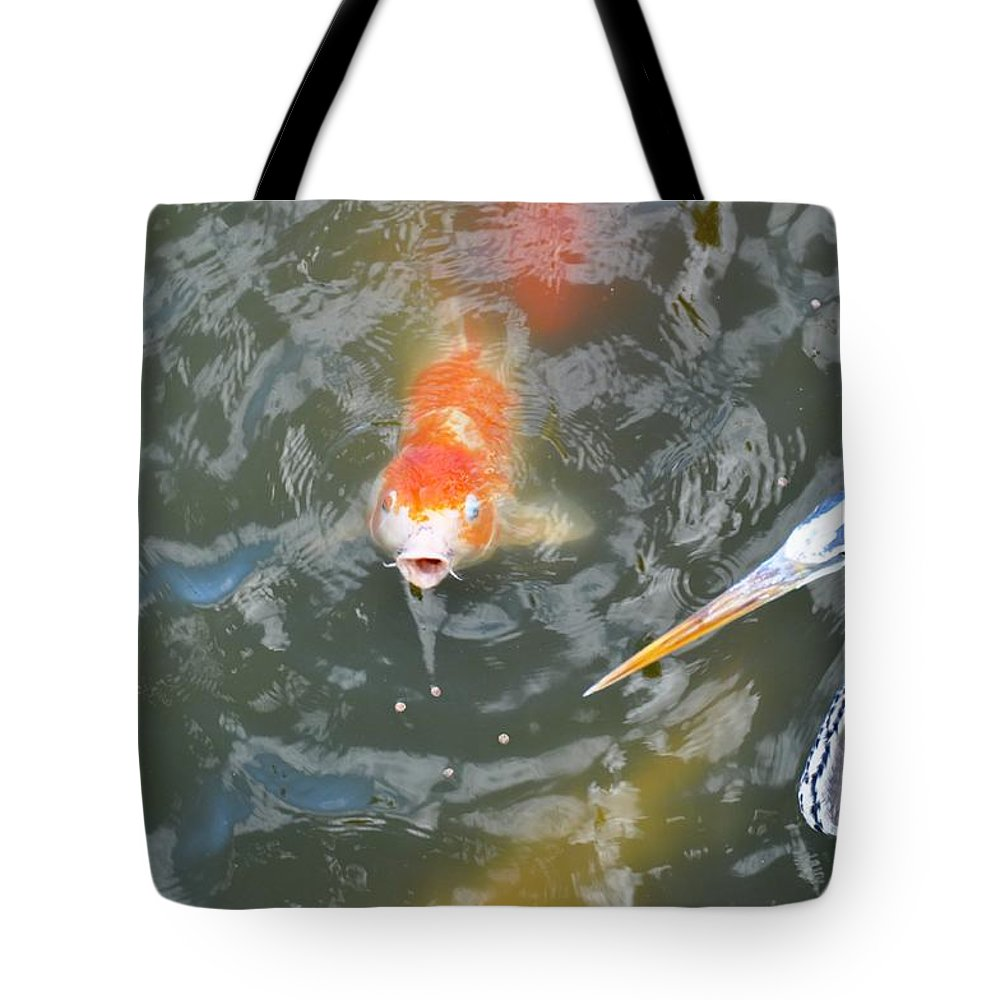 Fish Tote Bag featuring the photograph Koi And Great Blue Heron by Rich Bodane