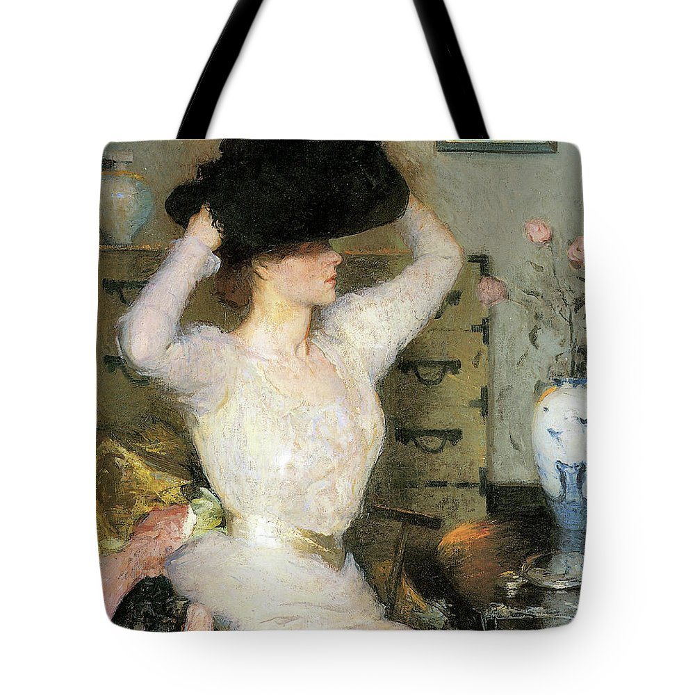 Lady Trying On A Hat Tote Bag featuring the photograph Lady Trying On A Ha by Frank Weston Benson