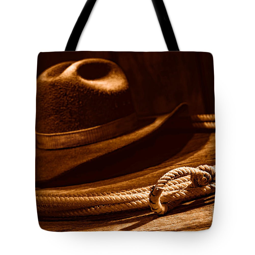 Cowboy Tote Bag featuring the photograph Lariat And Hat - Sepia by Olivier Le Queinec