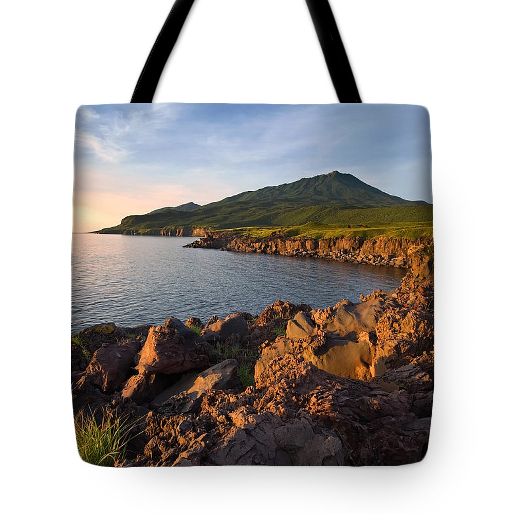 Season Tote Bag featuring the photograph Lava Field On The Coast Of The Island Of Iturup. Yankito Plateau. by Vladimir Serebryanskiy