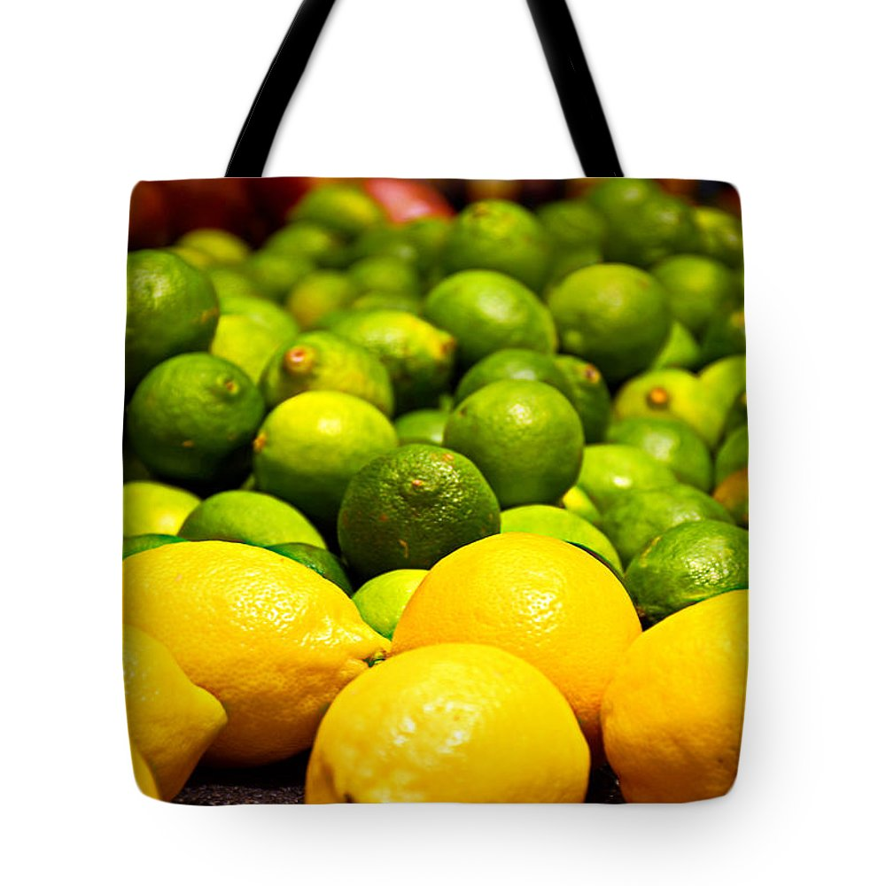 Lemons Tote Bag featuring the photograph Lemons And Limes by Robert Meyers-Lussier