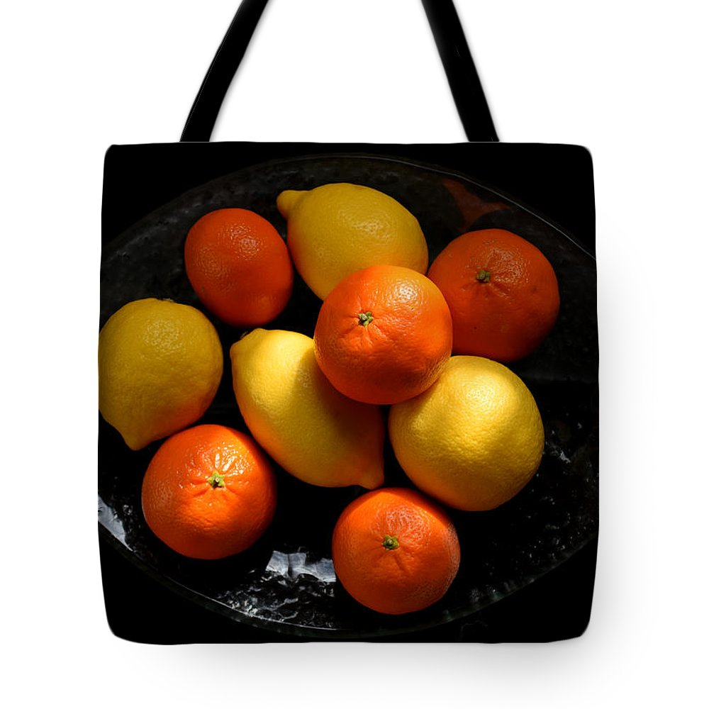 Lemons Tote Bag featuring the photograph Lemons And Oranges On A Platter by Ludmila SHUMILOVA