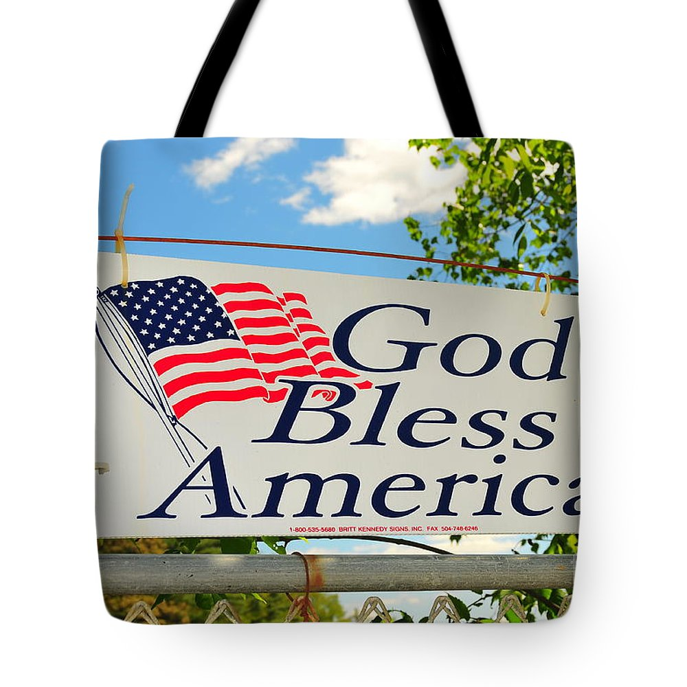 God Bless America American Flag Red White Blue Trees Clouds Blue Sky United States New England Vermont Wire Fence Rusty Old Metel Sign Chain Linked Old Tote Bag featuring the photograph Let Freedom Ring by Catherine Reusch Daley