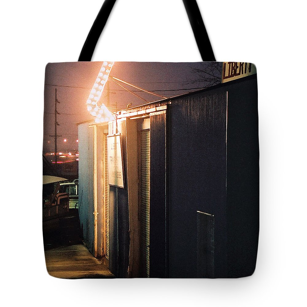 Night Scene Tote Bag featuring the photograph Liberty by Steve Karol