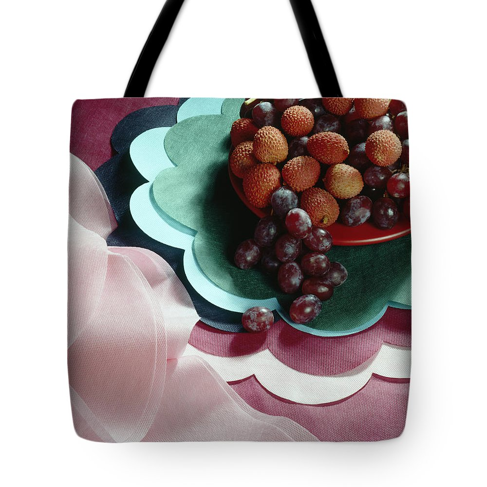Arty Tote Bag featuring the photograph Lichees And Grapes by Stefania Levi