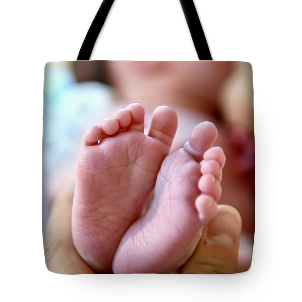Babies Feet Tote Bag featuring the photograph Life In My Hand by Jeramey Lende