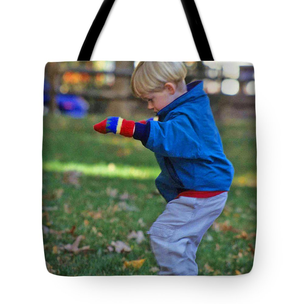 Boy Balancing Tote Bag featuring the photograph Life In Perfect Balance by Laurie Paci