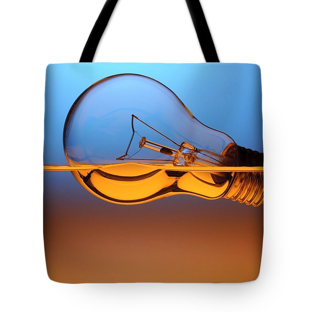 Alternative Tote Bag featuring the photograph Light Bulb In Water by Setsiri Silapasuwanchai