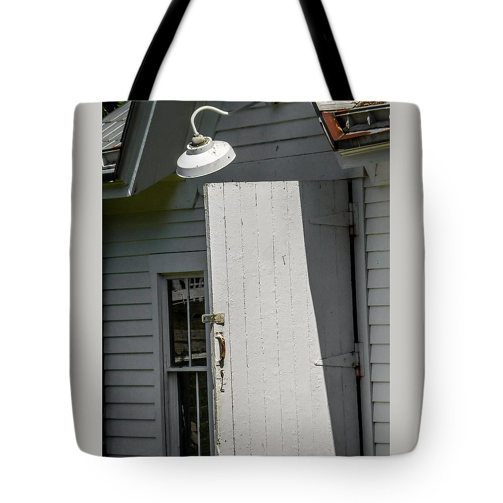Vertical Tote Bag featuring the photograph Light Over Opened Door by Robert Meyerson