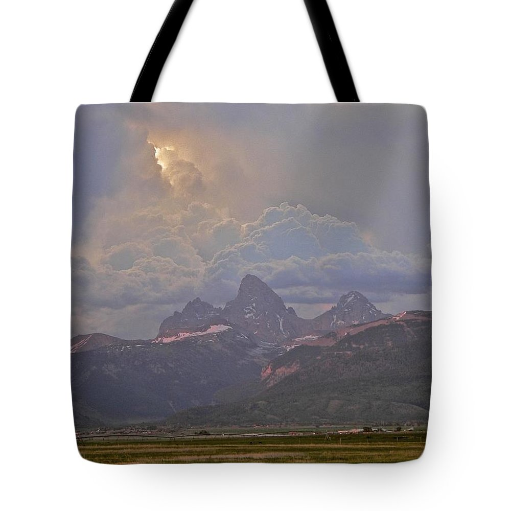 Sunlight Tote Bag featuring the photograph Light Storm by Eric Tressler