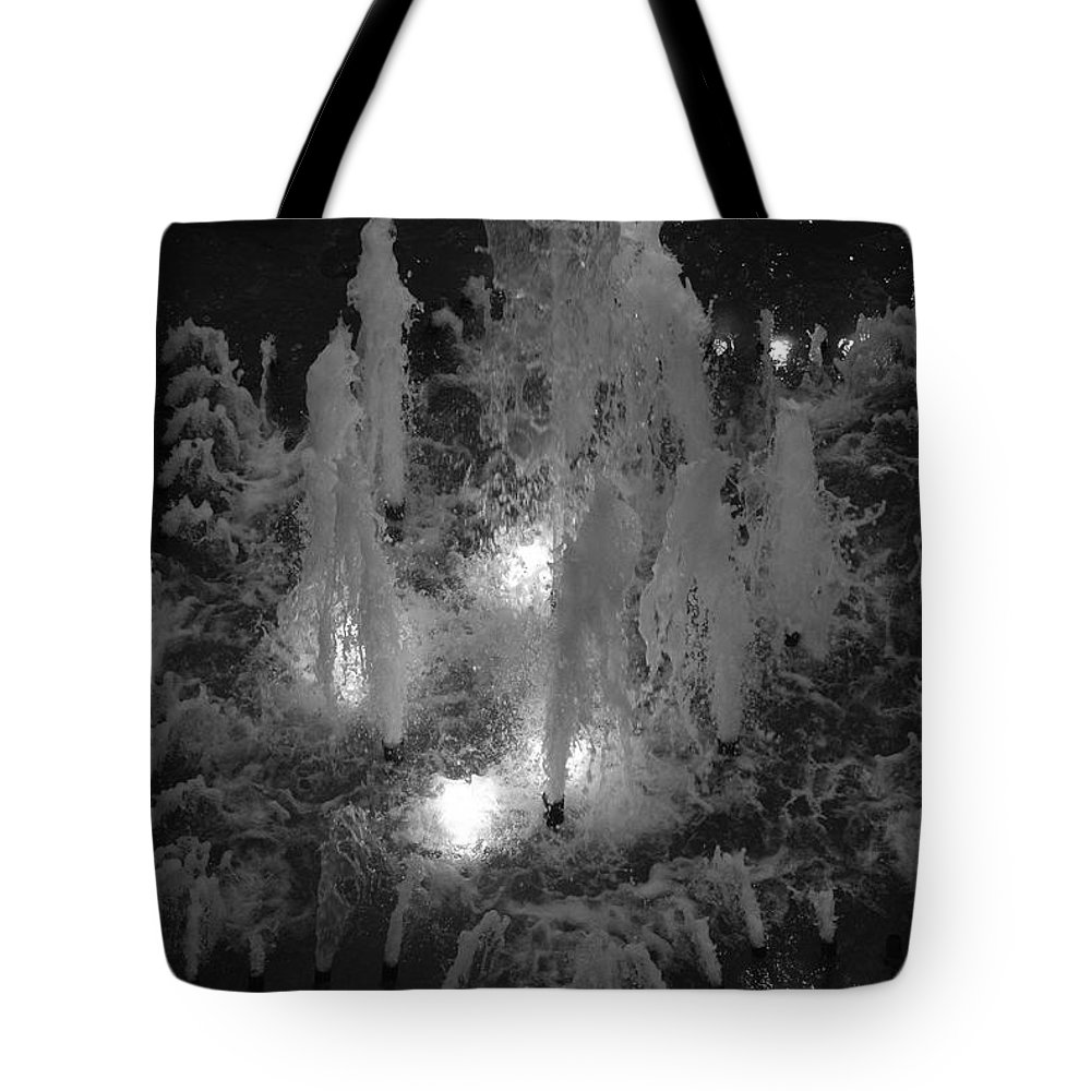 Fountian Tote Bag featuring the photograph Lighted Star Fountian by Rob Hans