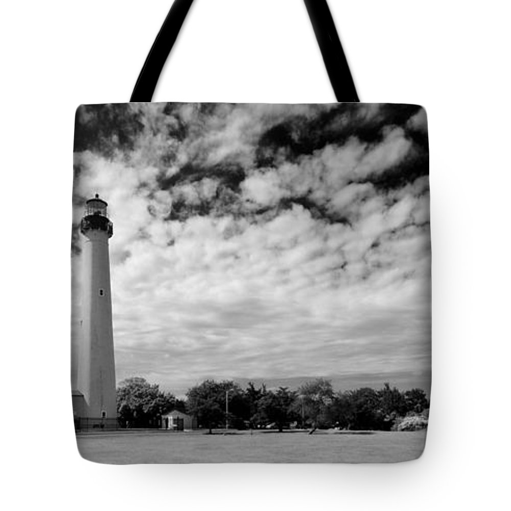 Lighthouse Tote Bag featuring the photograph Lighthouse And Sky by John Hoesly