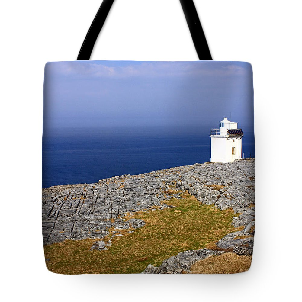 Lighthouses Tote Bag featuring the photograph Lighthouse Cliff by Jennifer Robin