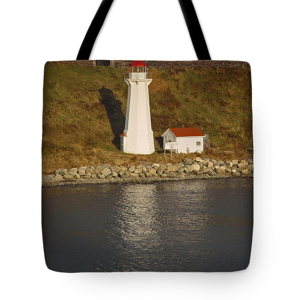 Lighthouse Tote Bag featuring the photograph Lighthouse In Maine by Heather Coen